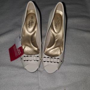 Brand new peep-toe heels size 7.5